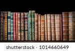 old books on wooden shelf.... | Shutterstock . vector #1014660649