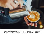 barista make coffee latte art... | Shutterstock . vector #1014672004