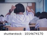 female students is combing her... | Shutterstock . vector #1014674170