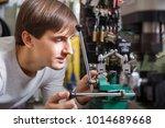 ordinary handyman making door... | Shutterstock . vector #1014689668