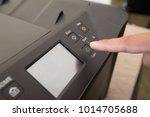 fingers hand press button on...   Shutterstock . vector #1014705688