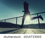 rear view to runner in blue t... | Shutterstock . vector #1014715003