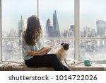 london view from window. woman... | Shutterstock . vector #1014722026