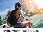 cheerful couple riding scooter... | Shutterstock . vector #1014722689