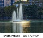 splashing fountain and evening... | Shutterstock . vector #1014724924