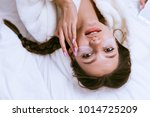 cute smiling girl lies on the... | Shutterstock . vector #1014725209