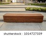 A Wooden Bench On Concrete...