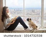 adorable woman with her dog... | Shutterstock . vector #1014732538