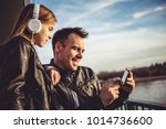 father and daughter wearing... | Shutterstock . vector #1014736600