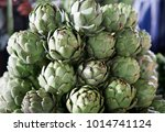 background of fresh artichokes. ... | Shutterstock . vector #1014741124