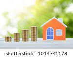 house model and coin money on... | Shutterstock . vector #1014741178
