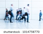 blurred people at a trade fair... | Shutterstock . vector #1014758770