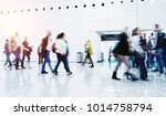 blurred people at a trade fair... | Shutterstock . vector #1014758794