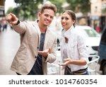 positive young traveller asking ... | Shutterstock . vector #1014760354