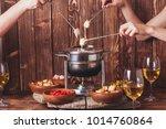 the cheese fondue | Shutterstock . vector #1014760864