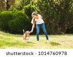 girl plays with a dog in the... | Shutterstock . vector #1014760978