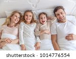 top view of young family... | Shutterstock . vector #1014776554