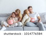 loving family watching movie on ...   Shutterstock . vector #1014776584