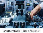 a pilot reaching for the... | Shutterstock . vector #1014783310