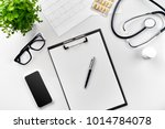 stethoscope in the office of... | Shutterstock . vector #1014784078