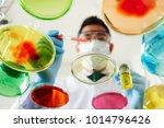 chemist dropping blood sample... | Shutterstock . vector #1014796426