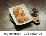 pancakes on a wooden board with ... | Shutterstock . vector #1014802408