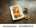 pancakes on a wooden board with ... | Shutterstock . vector #1014802414