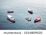 boats moored at sea surface | Shutterstock . vector #1014809020