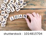 loan. wooden letters on the... | Shutterstock . vector #1014815704