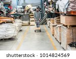 working at leather warehouse at ... | Shutterstock . vector #1014824569