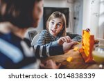 mother with two daughters... | Shutterstock . vector #1014838339