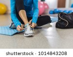 woman tying shoelace before... | Shutterstock . vector #1014843208