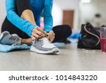 woman tying shoelace before... | Shutterstock . vector #1014843220