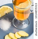 a cup of ginger tea with lemon... | Shutterstock . vector #1014855313