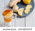 a cup of ginger tea with lemon... | Shutterstock . vector #1014855319
