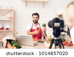 chef in red apron prepering... | Shutterstock . vector #1014857020