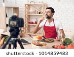 chef in red apron tasting wine... | Shutterstock . vector #1014859483