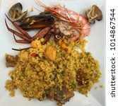 Small photo of Seafood paella on square plate