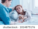 smiling caregiver visiting... | Shutterstock . vector #1014875176