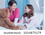 smiling nurse and young patient ... | Shutterstock . vector #1014875179
