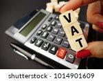 vat text on wooden cubes above...   Shutterstock . vector #1014901609