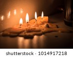 four wax candles almost... | Shutterstock . vector #1014917218