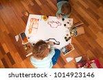 happy cheerful children drawing ... | Shutterstock . vector #1014923146