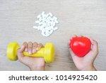 the hands holding red heart and ... | Shutterstock . vector #1014925420