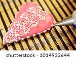 woman confectioner decorates...   Shutterstock . vector #1014932644