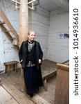 Small photo of TALLINN - ESTONIA / 06.25.2014: Woman at the old church in Rocca al Mare Estonian Open Air Museum, Tallinn, Estonia
