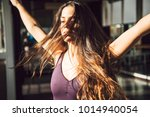 young brunette with long waving ...   Shutterstock . vector #1014940054