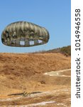 Small photo of Airborne troops landing with a parachute