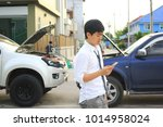 man sad with a broken car and... | Shutterstock . vector #1014958024