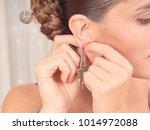 beautiful woman is wearing the... | Shutterstock . vector #1014972088